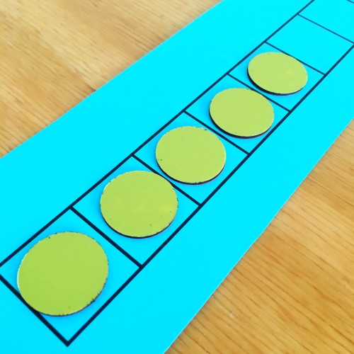 Use a simple grid and counters to have students practice segmenting - they push a counter into a box for each word in a sentence they hear! This post has other great ideas for phonological awareness activities and interventions.